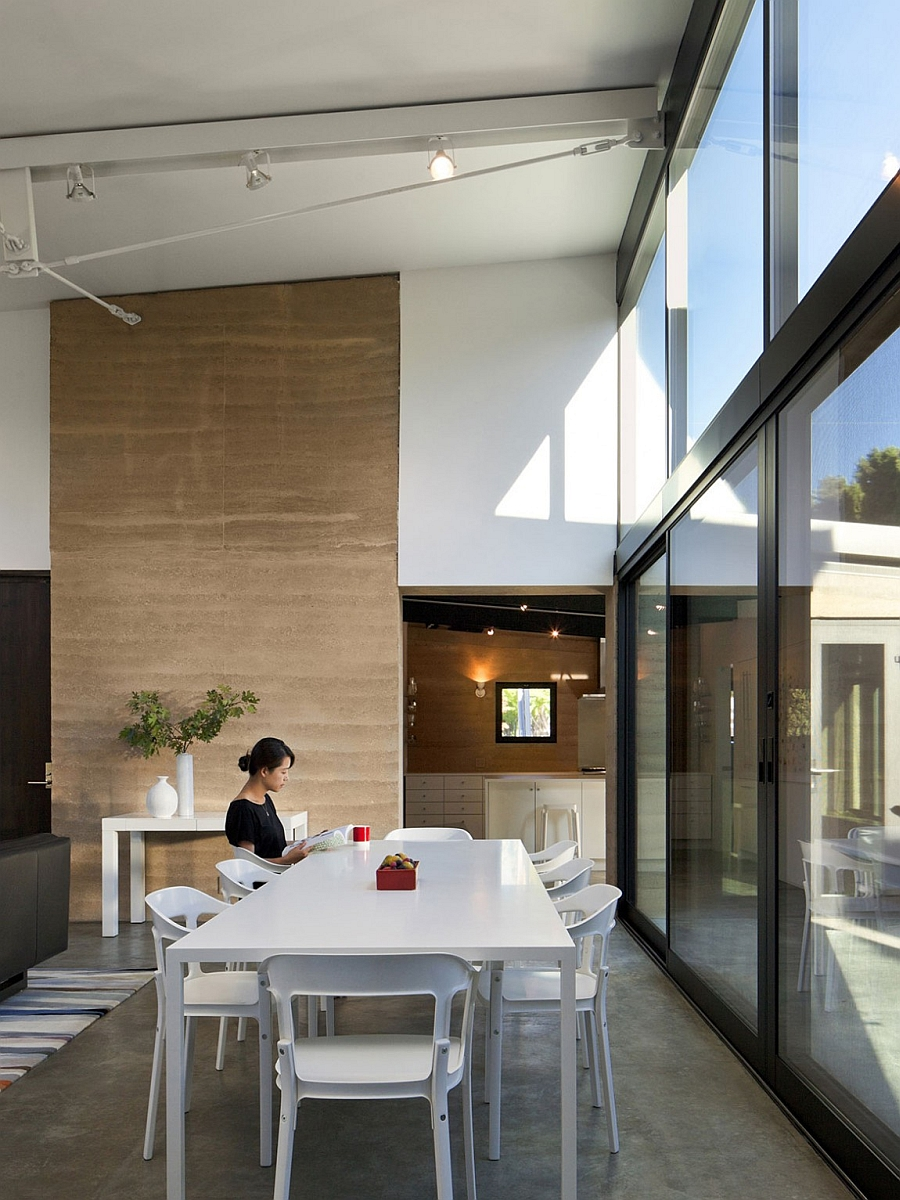 Sliding glass doors bring in ample natural ventilation