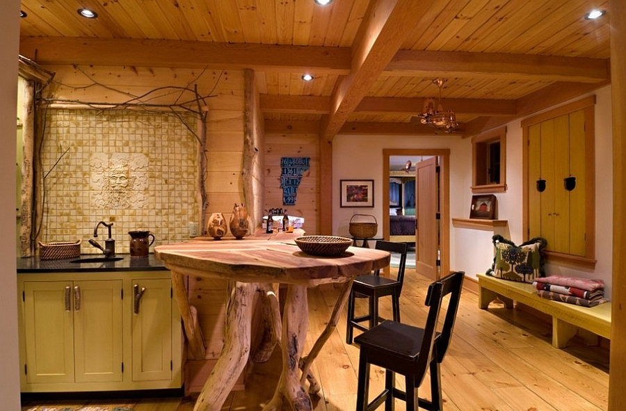 Small custom island crafted from natural tree trunks [Design: Laurel Feldman Interiors]