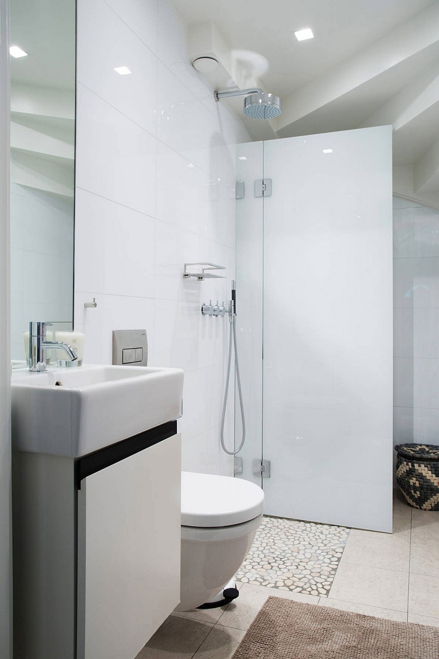 Small shower area in the white bathroom