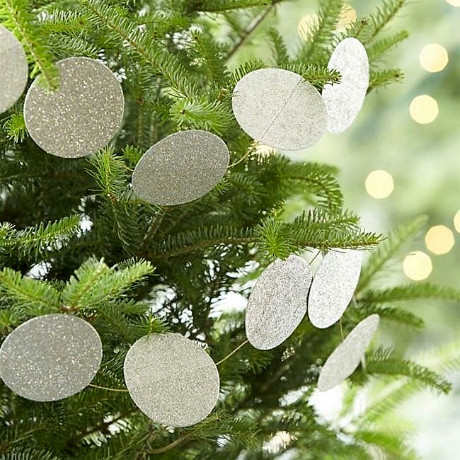 Sparkly garland on fresh greenery