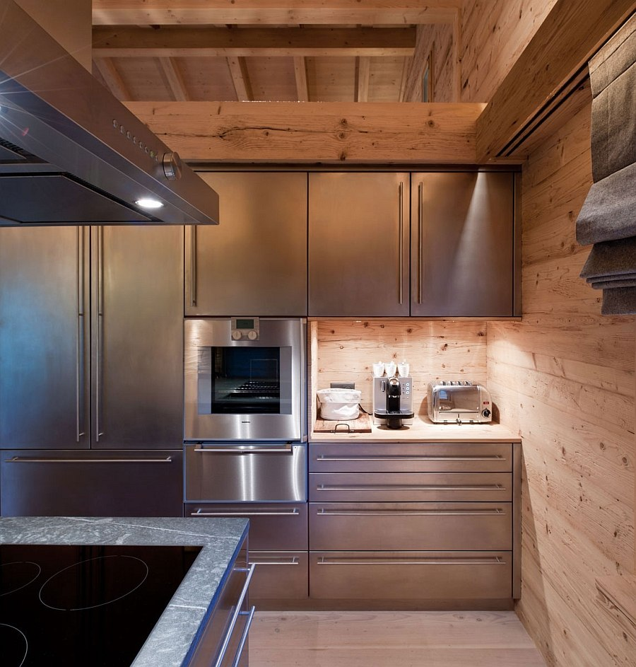 Stainless steel, stone and wood meet inside the chalet kitchen