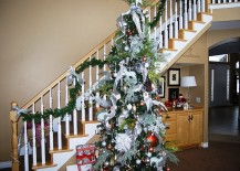 Staircase decorations complement the Christmas tree