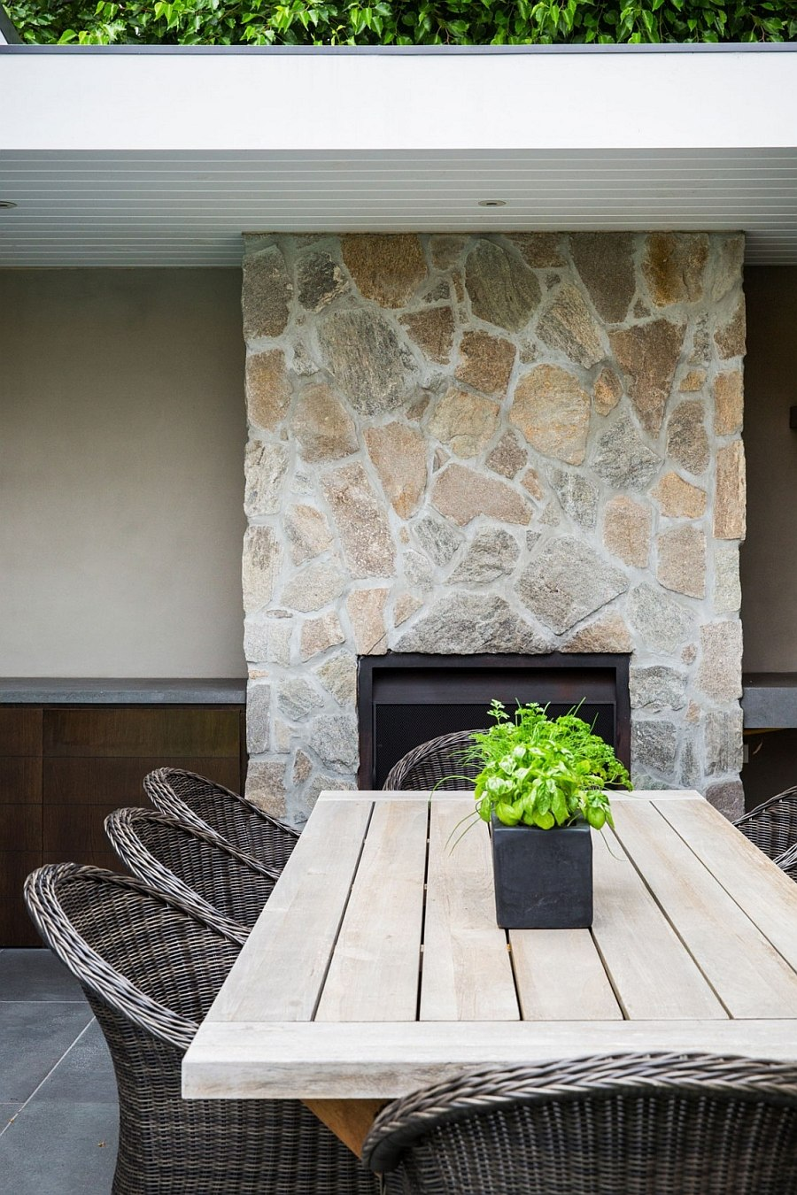 Stone fireplace acts as the perfect backdrop for the alfresco dining