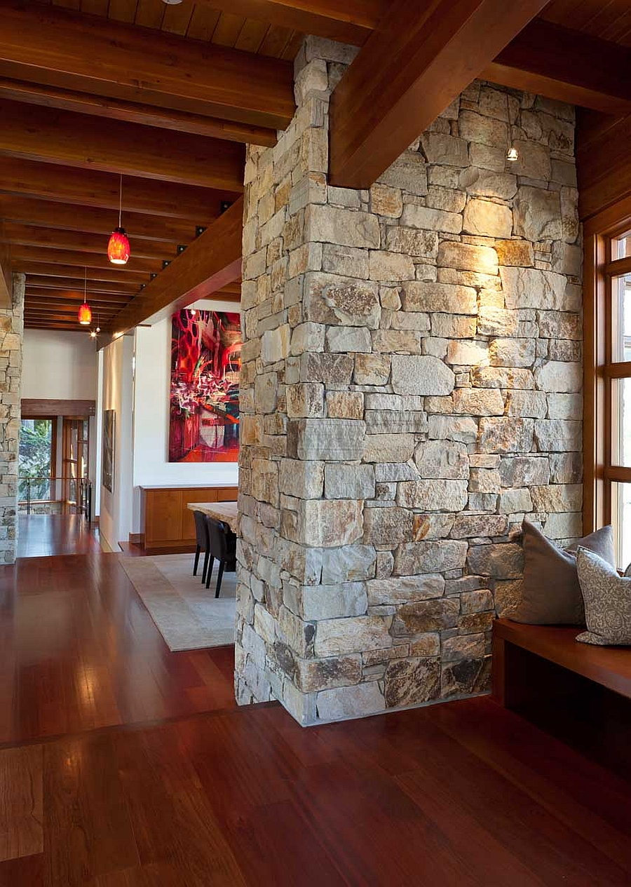 Stone wall brings a touch of rustic charm to the interior