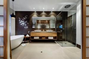 Tom Dixon pendant lighting in the bathroom [Design: Webb & Brown-Neaves]
