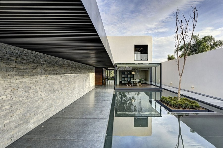 Tranquil pool leading to the living area of the house
