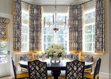 Transitional dining room in black and yellow