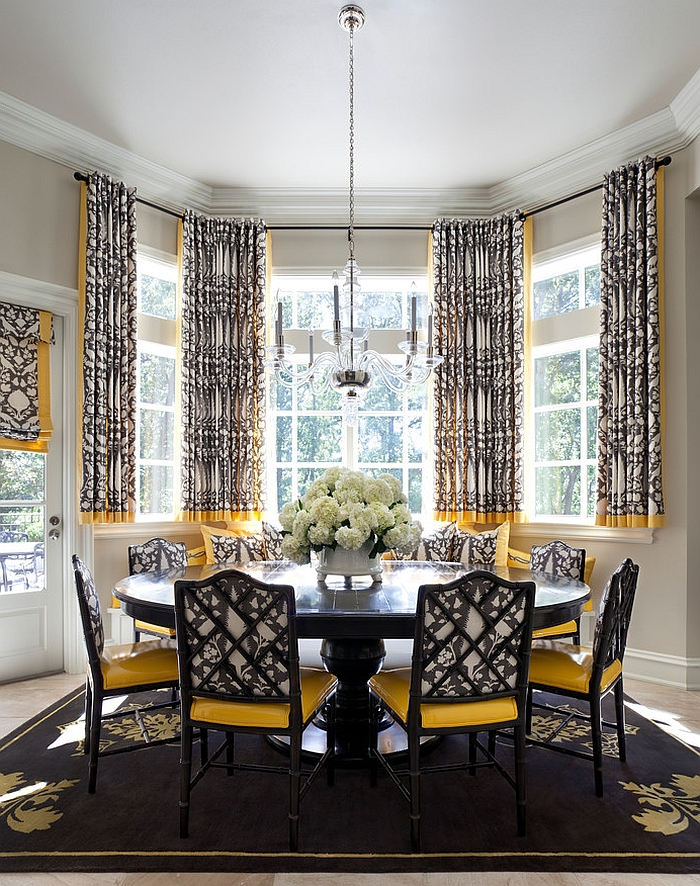 Transitional dining room in black and yellow [Design: Tobi Fairley Interior Design]