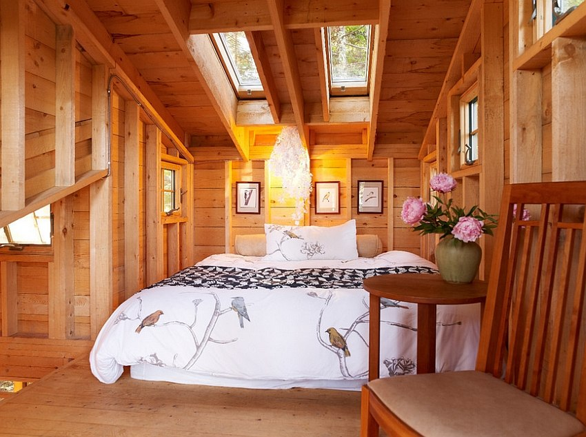 Twin skylights give the small attic bedroom a roomy appeal [Design: David Matero Architecture]