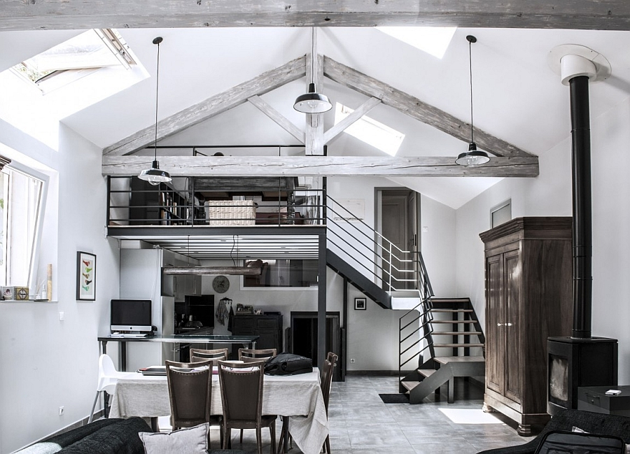 Vaulted ceiling and exposed wooden beams give the transformed home a classic appeal