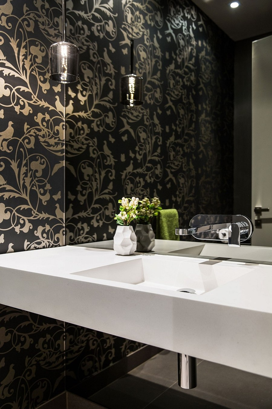 Wallpaper brings an air of luxury to the powder room