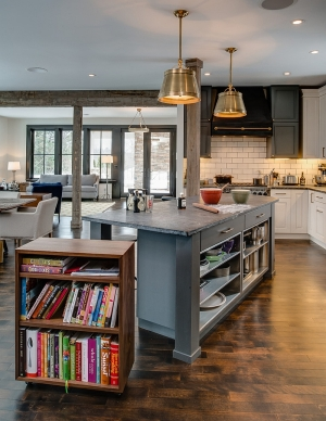 Walnut bookshelf that rolls out from the kitchen island