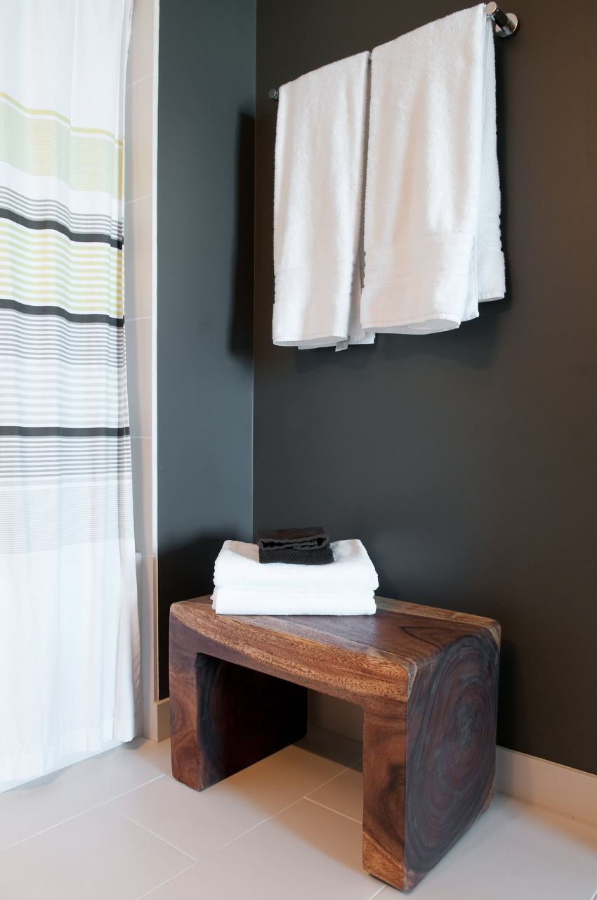 Wooden stool with cozy towels