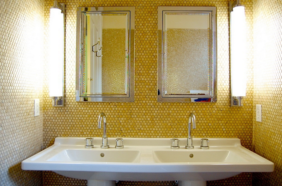 Yellow penny tiles add golden glint to the small bathroom [Photography: Corynne Pless]
