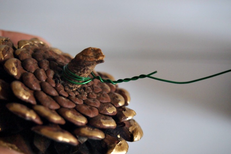 attaching wire to painted pine cone
