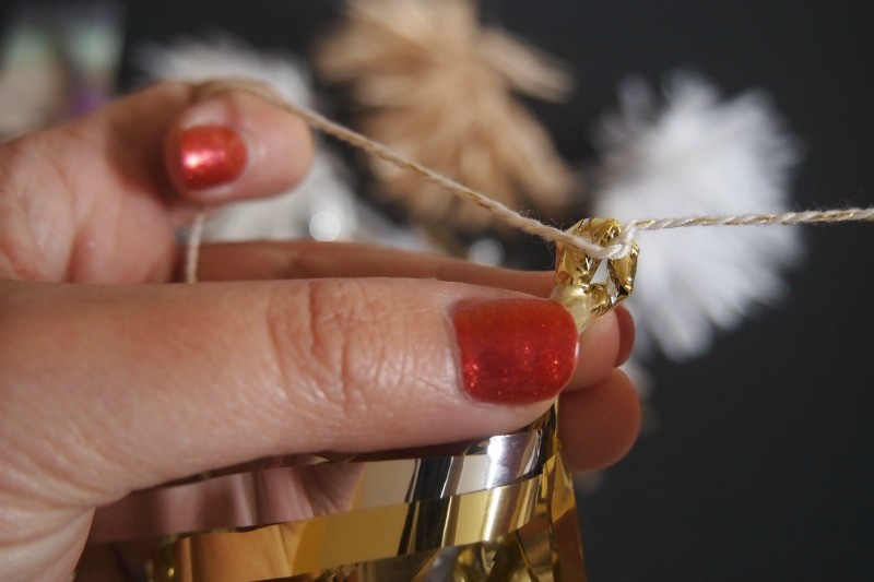 making a garland with tassels