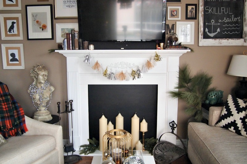 tassel garland on fireplace mantle