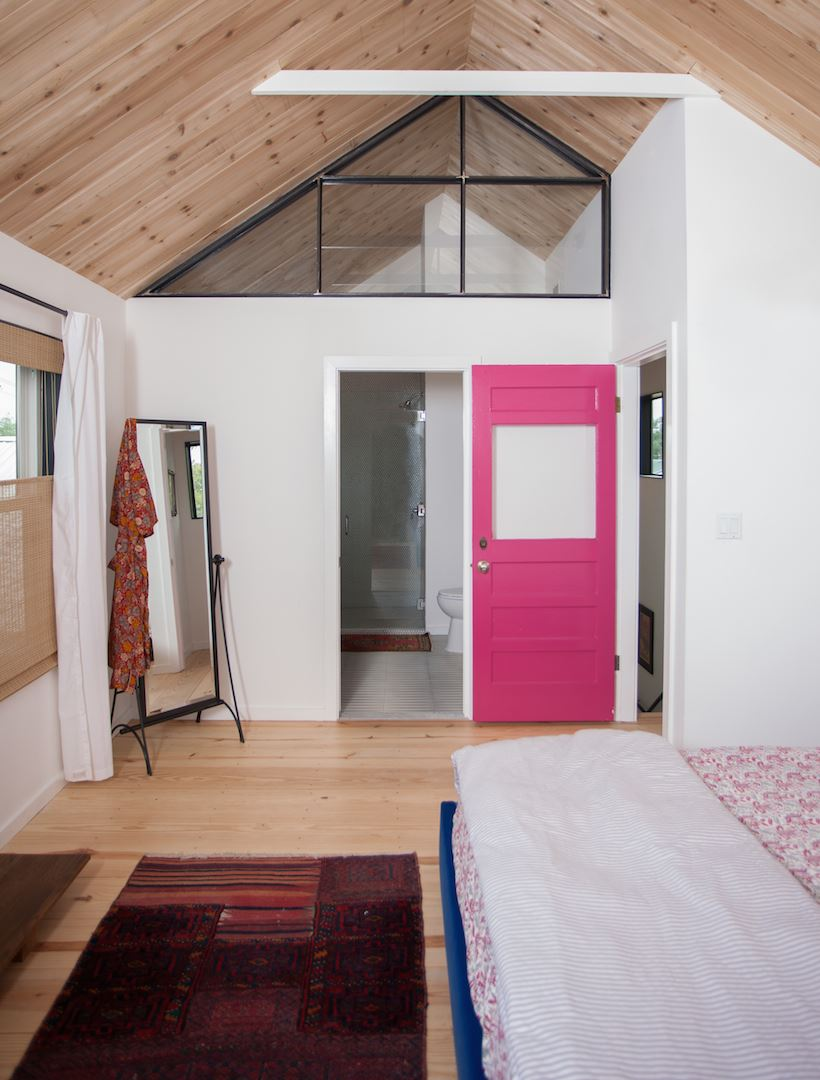 A pink door makes a bold statement in the bungalow of Ashton Arthur (photo by Jessica Pages)
