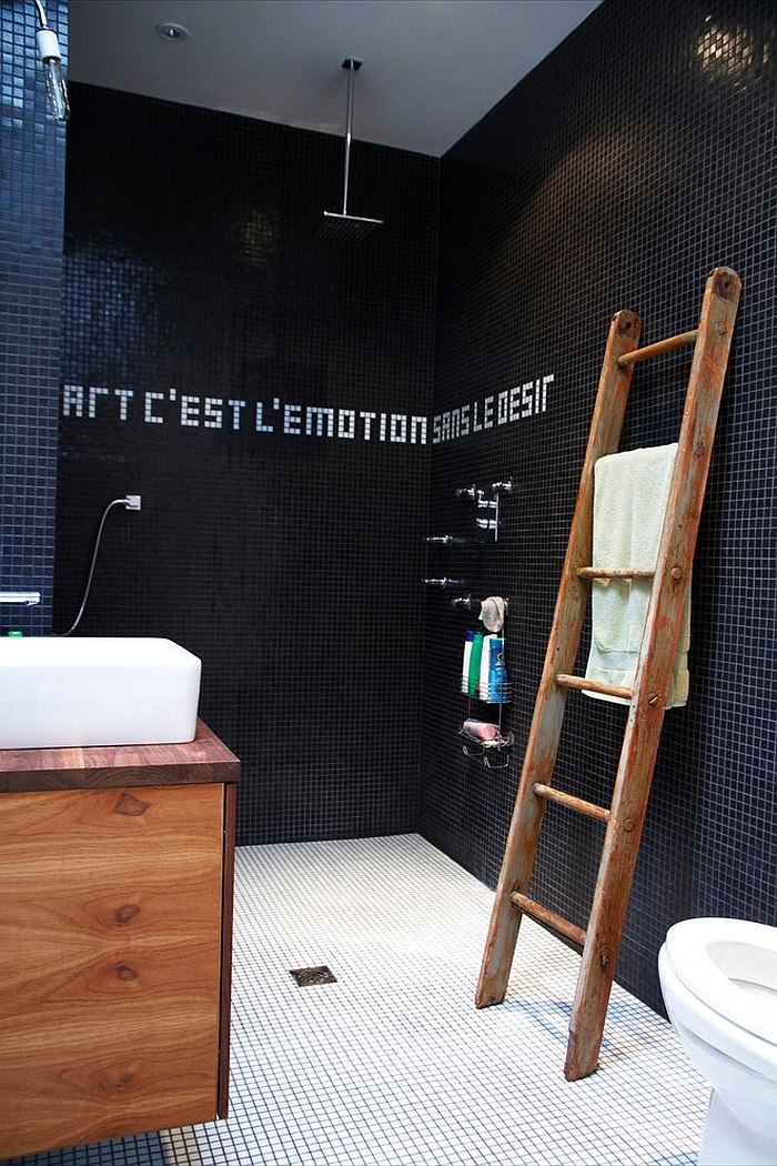 An inspirational quote on the bathroom walls with tiles! [Design: Esther Hershcovich]