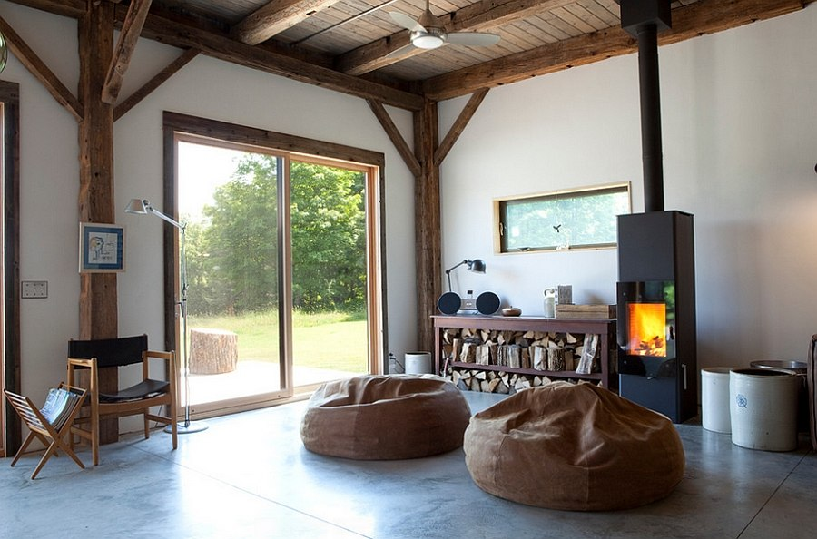 Airy rustic living room with a Danish woodstove [Design: Kimberly Peck Architect]