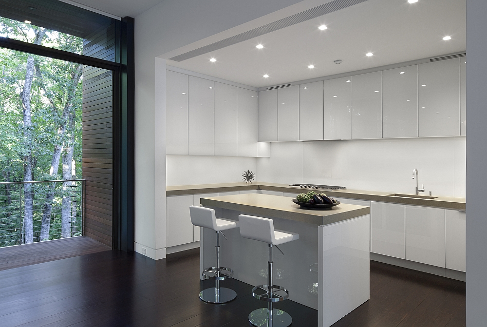 All-white contemporary kitchen with a breakfast zone