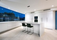 All-white contemporary kitchen with large glass windows