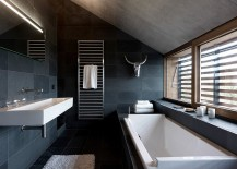 Ample natural light gives the dark bathroom a more airy vibe