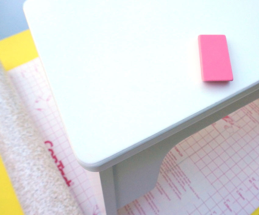 An eraser cleans up pencil marks