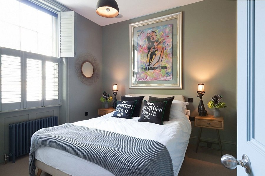 Art work above the bed adds a pop of color to the bedroom