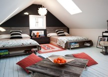 Attic kids' bedroom with low furnishings and skylight
