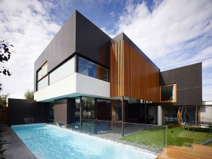 Backyard of the contemporary Geelong home with a refreshing pool and lovely garden