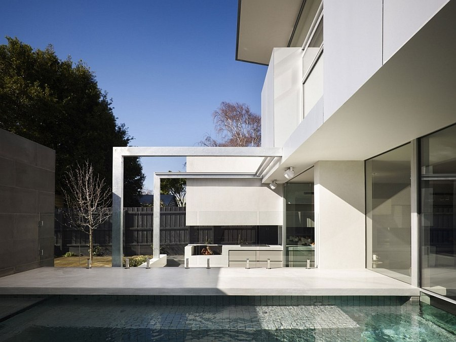Backyard pool and barbecue area of the gorgeous Mebourne house Charming Modern Addition Revitalizes Elegant Edwardian Home