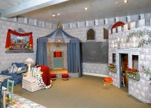 Basement playroom stage designed as a jousting tent