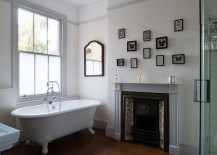 Bathroom with a claw-foot bathtub and a gallery wall