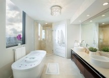 Bathroom with ocean views and standalone bathtub in white