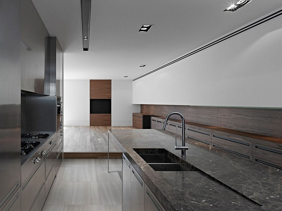 Beautiful blend of stone, wood and metal in the modern kitchen