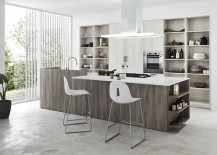 Beautiful kitchen island brings additional storage and display options