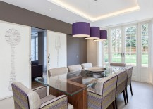 Beautiful purple pendants add color to the room without altering its relaxed ambiance