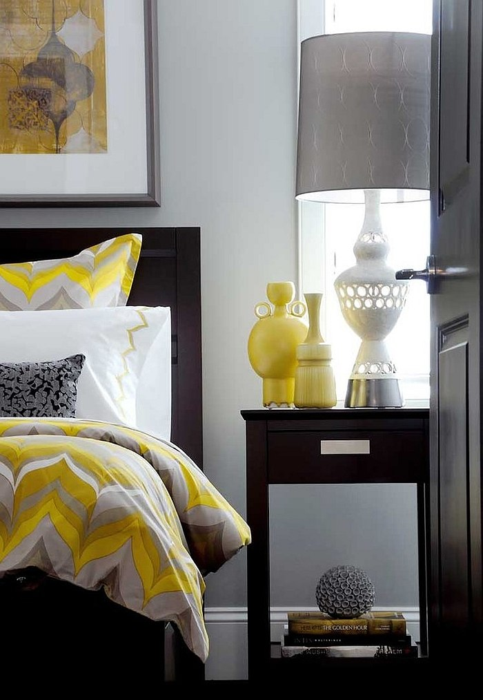 Bedding and vases add pops of yellow to the gray bedroom [Design: Atmosphere Interior Design]