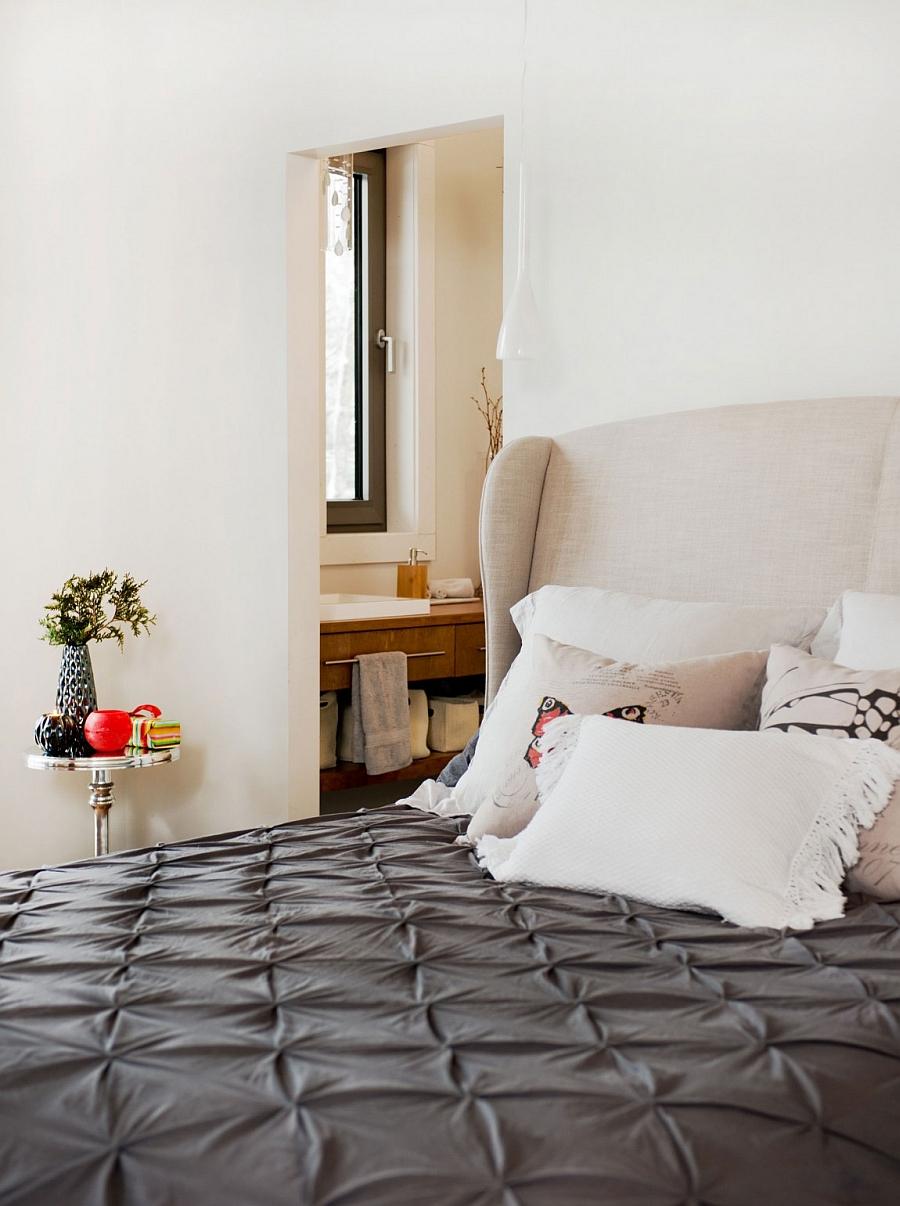 Bedside pendants and sleek side table make smart use of space