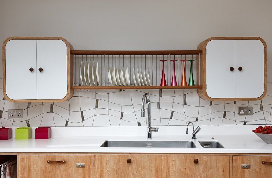 Bespoke tiled backsplash and unique cupboads give the space a stunning look