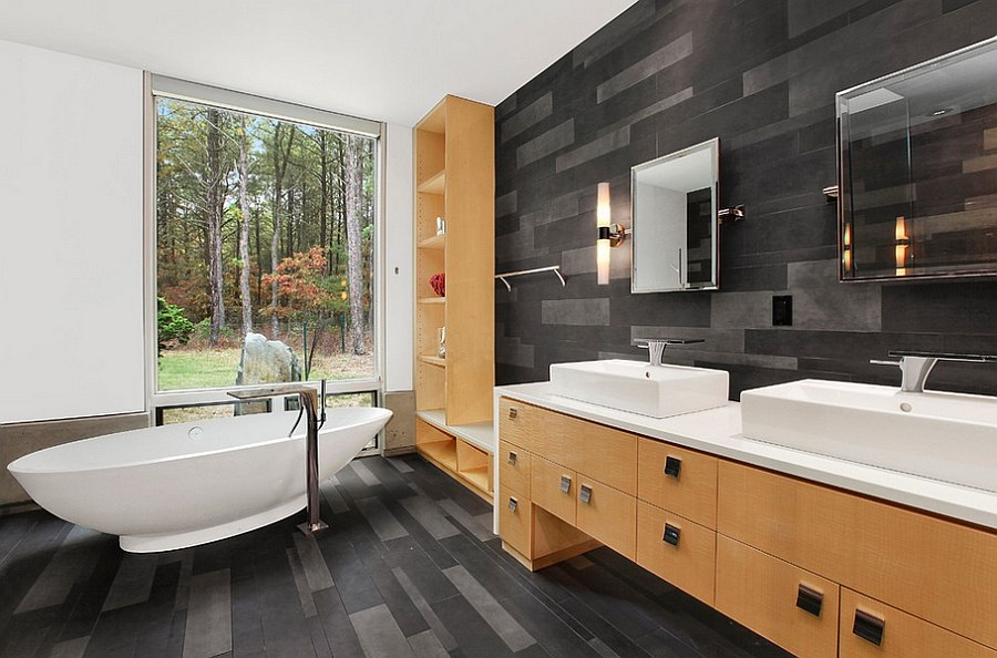 Black and gray bring an aura of sophistication to the contemporary bathroom [Design: William Roy Designer Kitchens]