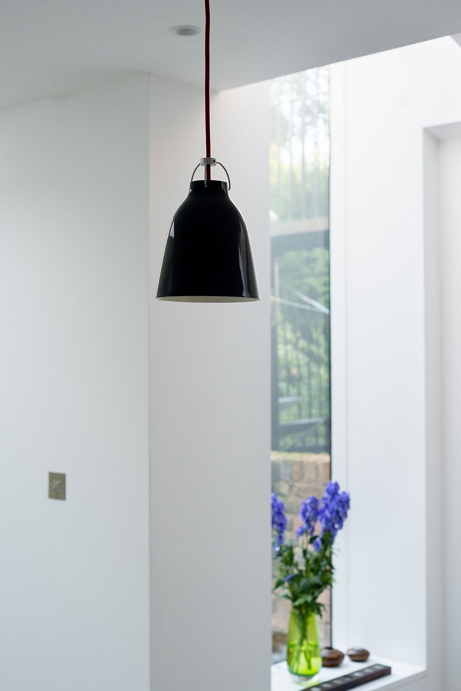 Black pendant light in the modern kitchen