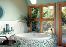 Bluish-green gives a serene vibe to the spa-styled master bath