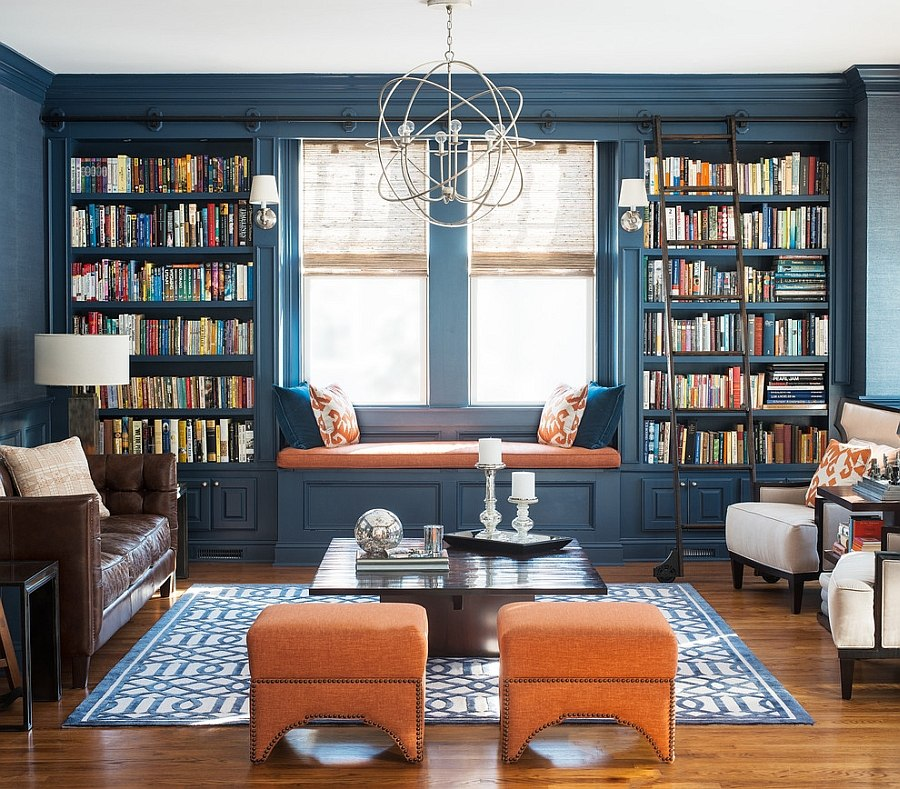 Book display in dark blue offers the perfect backdrop for the living room [Design: Cory Connor Designs]