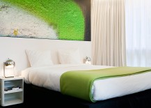 Brilliant artwork on the wall complements the color scheme in each room