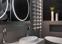 Brilliantly lit contemporary bathroom with unique mirrors and vanity