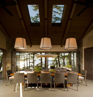 Captivating dining room with gorgeous views and twin skylights [Design: Christian Grevstad]