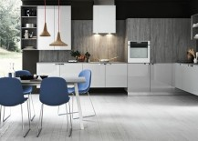 Chairs in blue and pendant lights add to the appeal of the smart kitchen 217x155 11 Inspired Contemporary Kitchens with Compositional Freedom