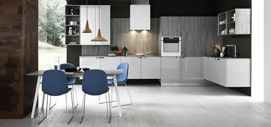 Chairs in blue and pendant lights add to the appeal of the smart kitchen